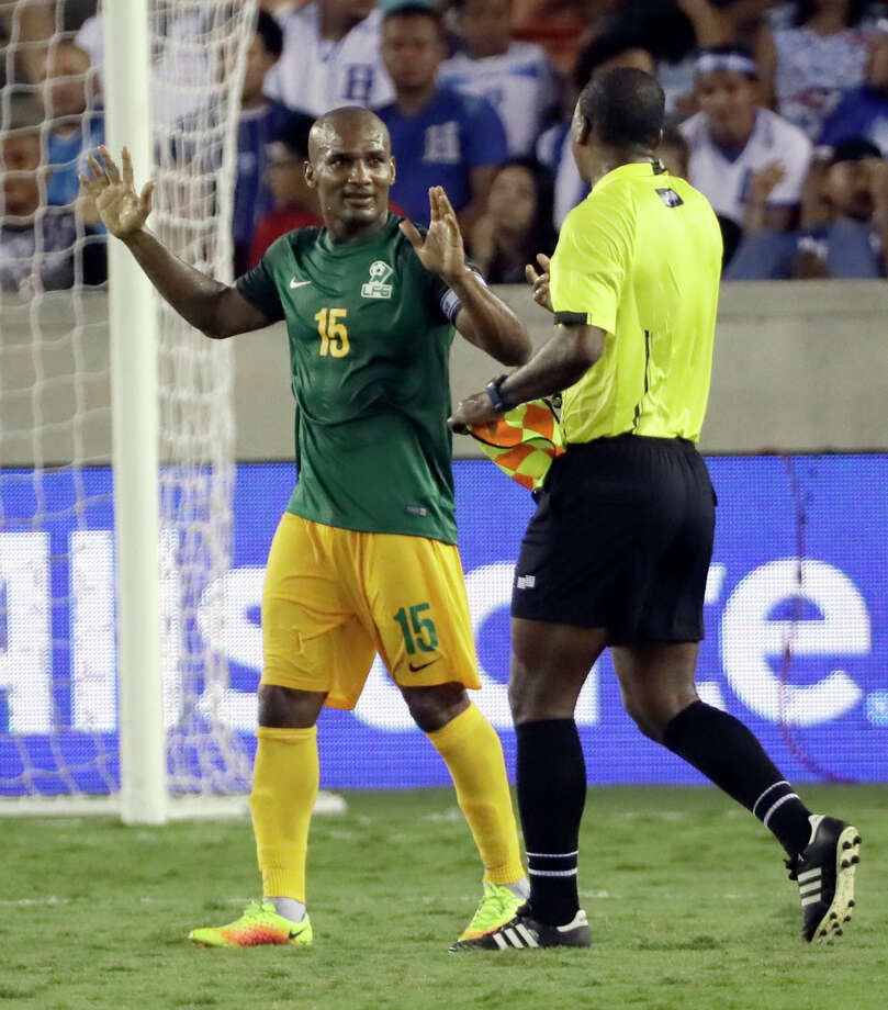 French Guiana midfielder Florent Malouda (15) talks with a linesman at halftime during a CONCACAF Gold Cup soccer match against Honduras on Tuesday, July 11, 2017, in Houston. (AP Photo/David J. Phillip) Photo: David J. Phillip, Associated Press / Copyright 2017 The Associated Press. All rights reserved.