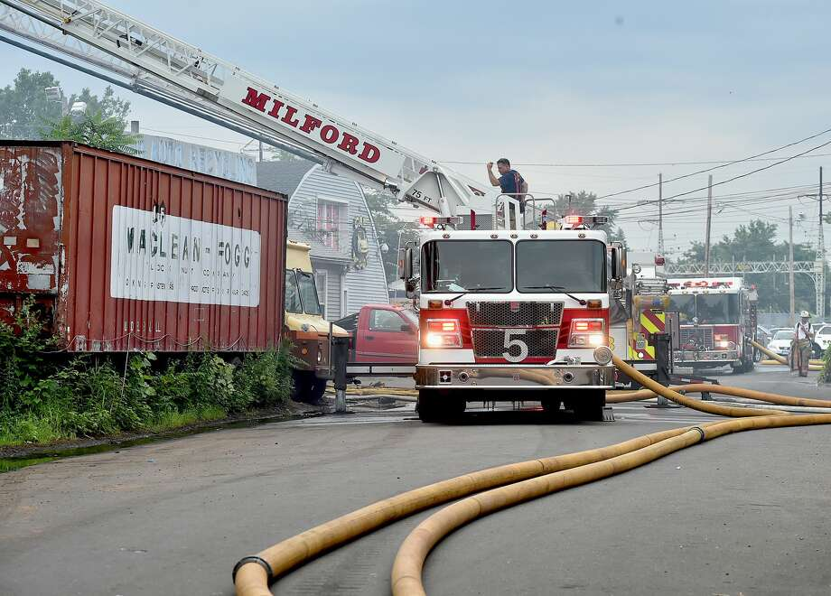 Milford firefighters battle a large fire, Tuesday, July 11, 2017, at the Milford Auto Recycling at 70 South Washington St, in Milford that produced heavy smoke in the area of Bridgeport Avenue, also known as Route 1. Also on the scene, Stratford, West Haven, New Haven and Fairfield. (Catherine Avalone / Hearst Connecticut Media) Photo: Catherine Avalone/Catherine Avalone/New Haven Regi