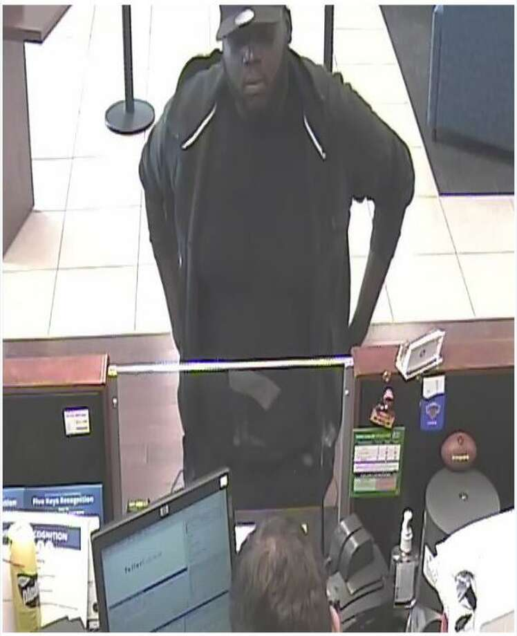 Surveillance footage shows the suspect of the July 11 robbery of the Noroton Ave. Chase Bank in Darien, Conn. Photo: Darien News/Contributed / Contributed Photo / Darien News