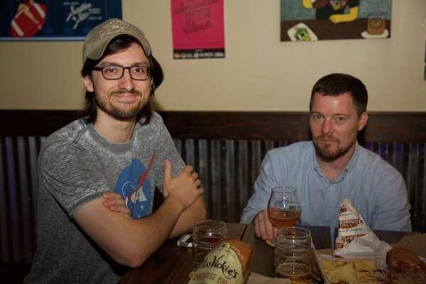 Dan Herman and Benjamin Trent enjoy a beer at Big Hops on Bitters Road.