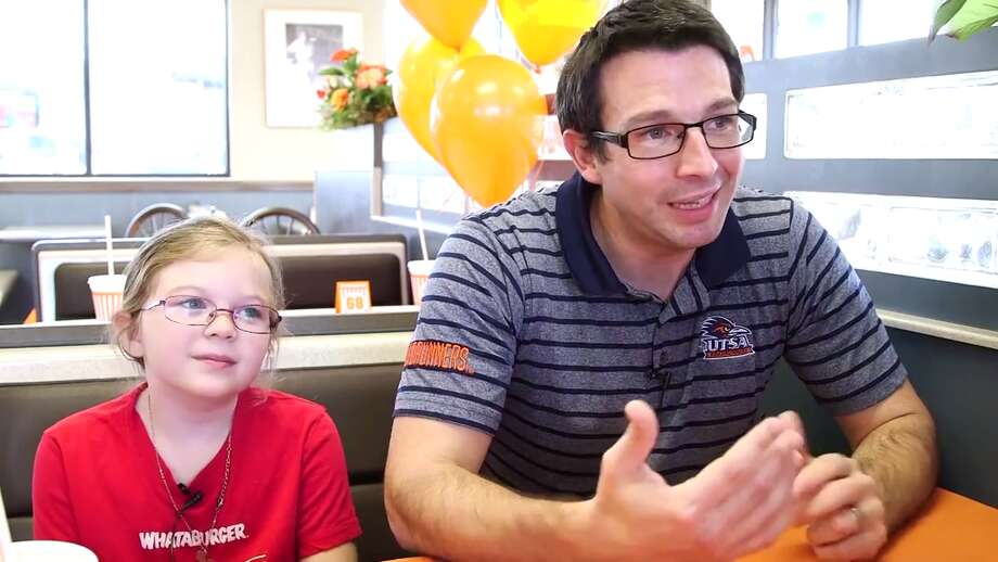 Whataburger recently released a video detailing the journey of a father, Brian Cordeau, and his young daughter Kalli's visits to 68 of the burger chain's locations in San Antonio. Photo: Whataburger / YouTube