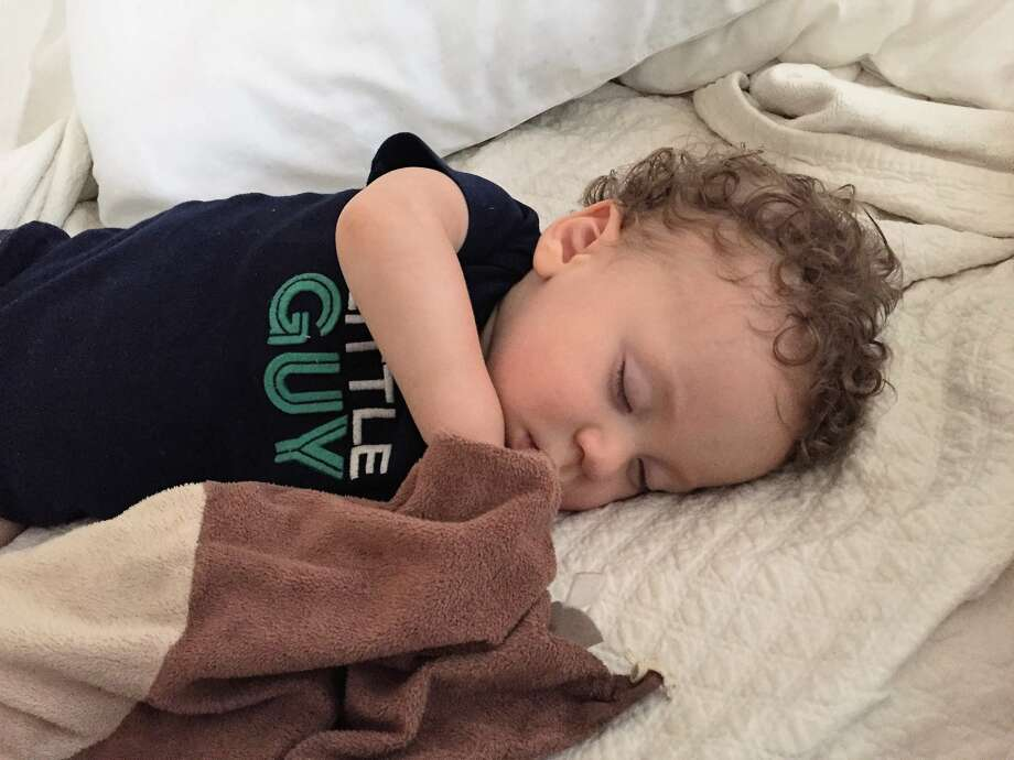 """Milo, snuggling his """"Monk-Monk,"""" and listening to Jason Isbell."""