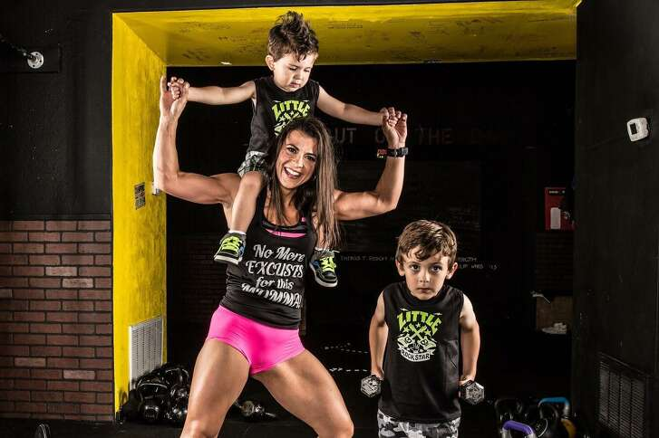 Helen Costa-Giles is seen with her two sons after she lost 90 pounds and got in shape as the leader of a thrice-weekly boot camp that starts at 4 a.m.