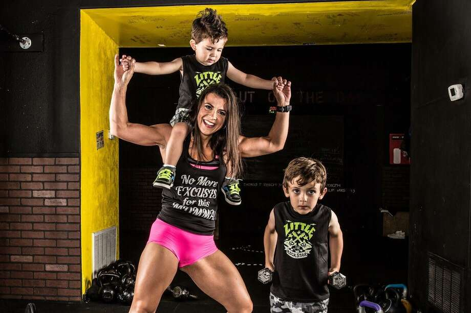 Helen Costa-Giles is seen with her two sons after she lost 90 pounds and got in shape as the leader of a thrice-weekly boot camp that starts at 4 a.m. Photo: Courtesy Photo