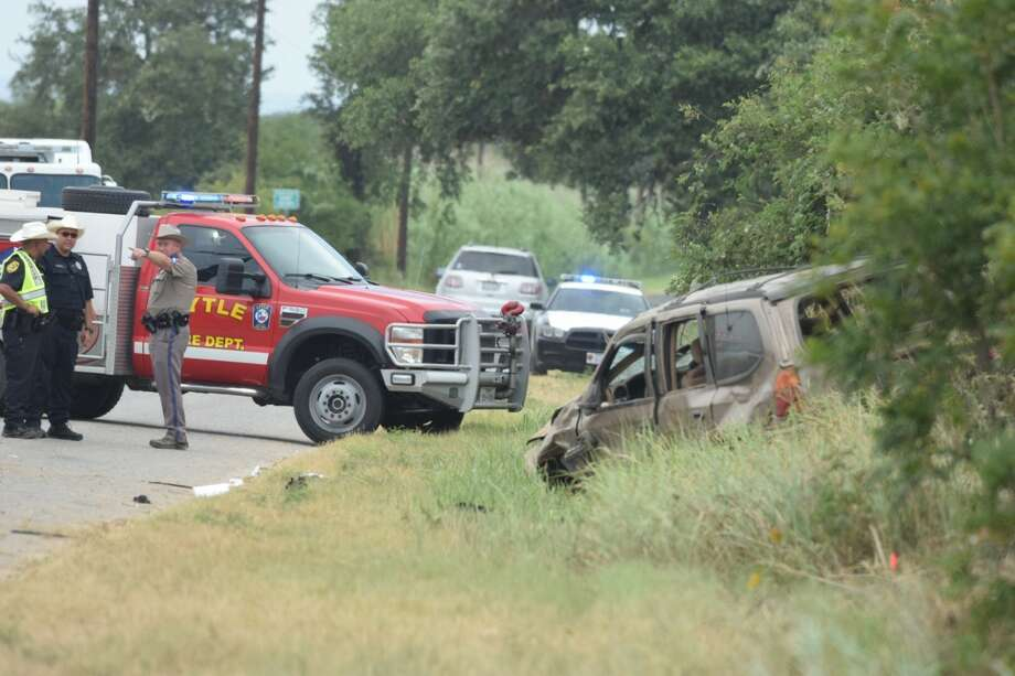 "Emergency helicopters and Bexar County sheriff's deputies are responding to a ""critical"" single vehicle rollover in Southwest Bexar County on Wednesday, July 12, 2017. Photo: Caleb Downs / San Antonio Express-News"