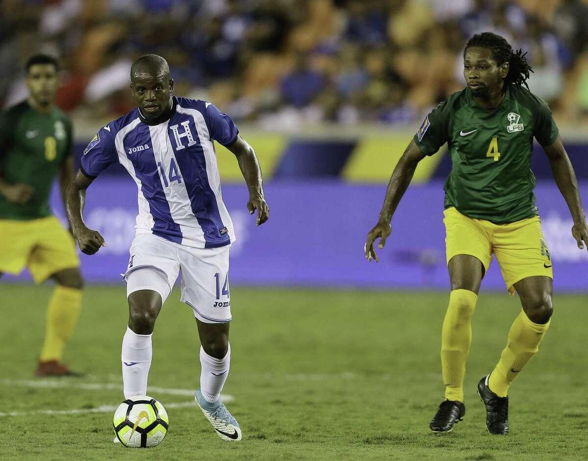 HOUSTON, TX - JULY 11: Boniek Garcia #14 of Honduras dribbles around Rhudy evens #4 of French Guiana in the second half at BBVA Compass Stadium on July 11, 2017 in Houston, Texas.