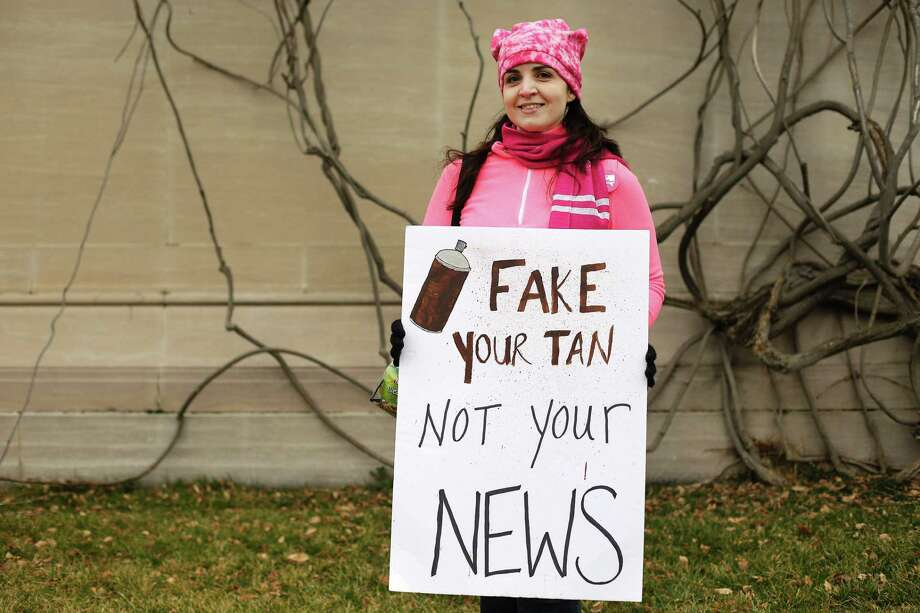 "A protester displays a sign referring to ""Fake News"" in Washington, D.C., during the Womens March on Jan. 21, 2017. Photo: Joshua Lott /AFP /Getty Images / AFP or licensors"