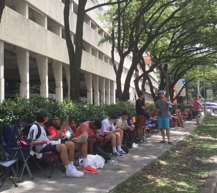 Houstonians wait in line outside of the Galleria after hearing rumors about a popup shop for the Louis Vuitton collaboration with Supreme streetwear brand. Some of the people in line have been waiting since Sunday. Photo: Joy Sewing