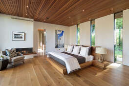 A newly built 5,000-square-foot home inspired by its natural setting among the redwood trees of Ross, Calif., is on the market for $15 million. Pictured here is the master bedroom.