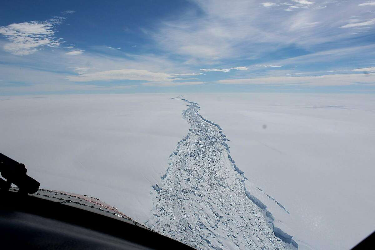 In a photo released by the British Antarctic Survey, a fissure in the Larsen C ice shelf, seen from air in February 2017. A chunk of floating ice weighing more than a trillion metric tons broke away from the Antarctic Peninsula here, producing one of the largest icebergs ever recorded, scientists confirmed on July 12, 2017. (British Antarctic Survey via The New York Times) -- FOR EDITORIAL USE ONLY --