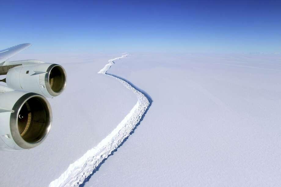 A rift in the Antarctic Peninsula's Larsen C ice shelf broke open and calved a vast iceberg, scientists said Wednesday. Photo: John Sonntag, Associated Press