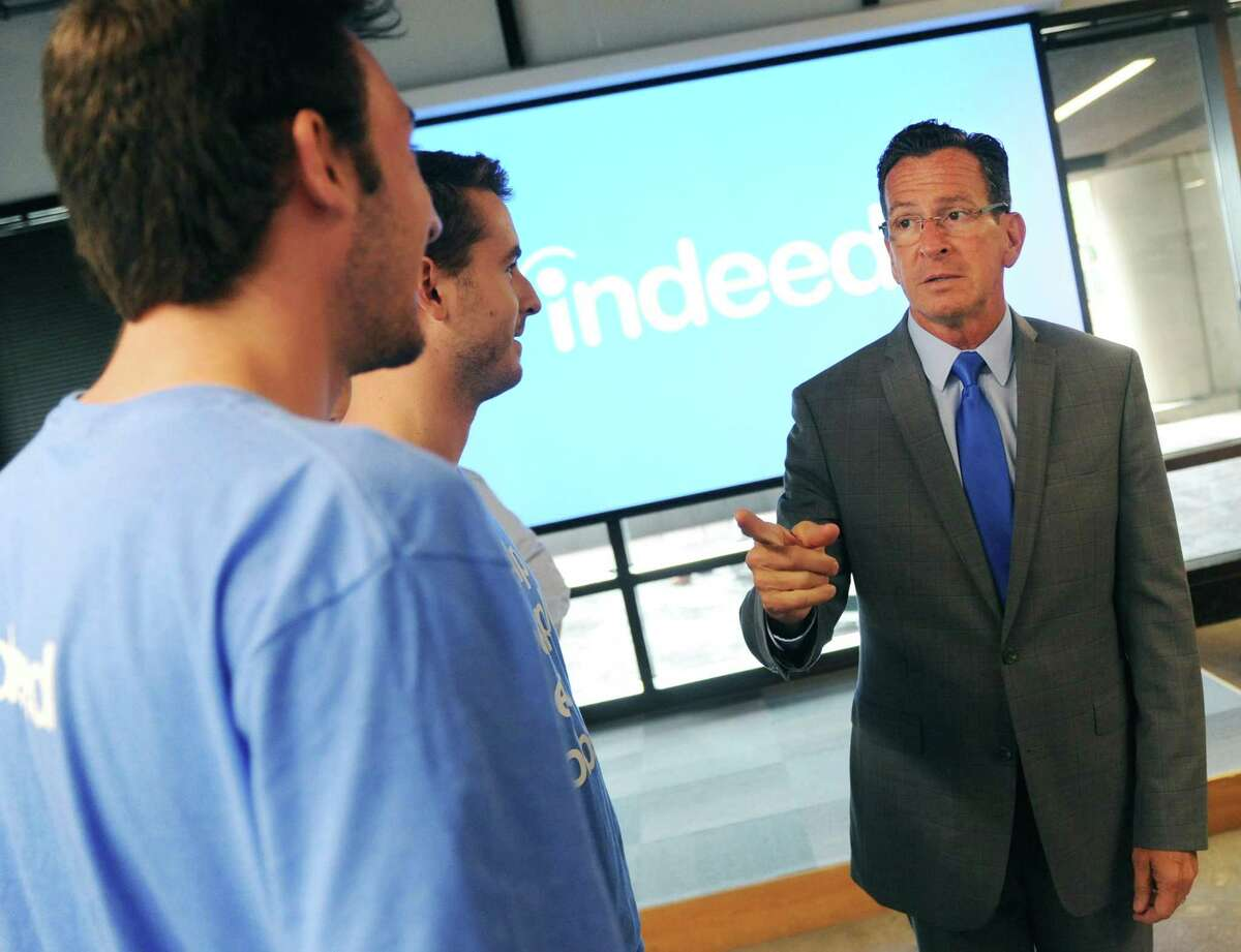 Connecticut Gov. Dannel P. Malloy chats with employees after making an announcement at the Indeed headquarters in Stamford. Online job-search giant Indeed plans to create up to 500 new jobs over the next few years through tens of millions of dollars in company investment and state aid, Gov. Dannel P. Malloy and company executives announced Wednesday.