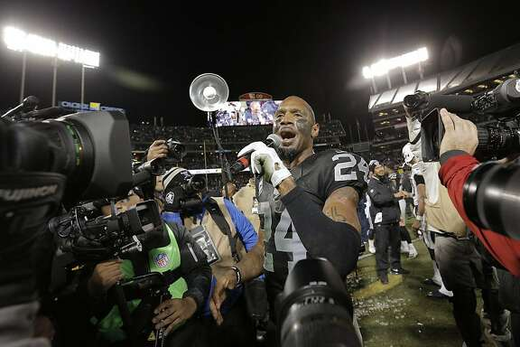 Charles Woodson (24) addresses the crowd as he is honored for his career after the Oakland Raiders defeated the San Diego Chargers at O.Co Coliseum in Oakland, Calif., on Thursday, December 24, 2015.