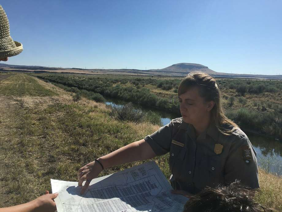 Ranger Angela Sutton shows visitors a map of the Tule Lake Segregation Center Photo: Vanessa Hua