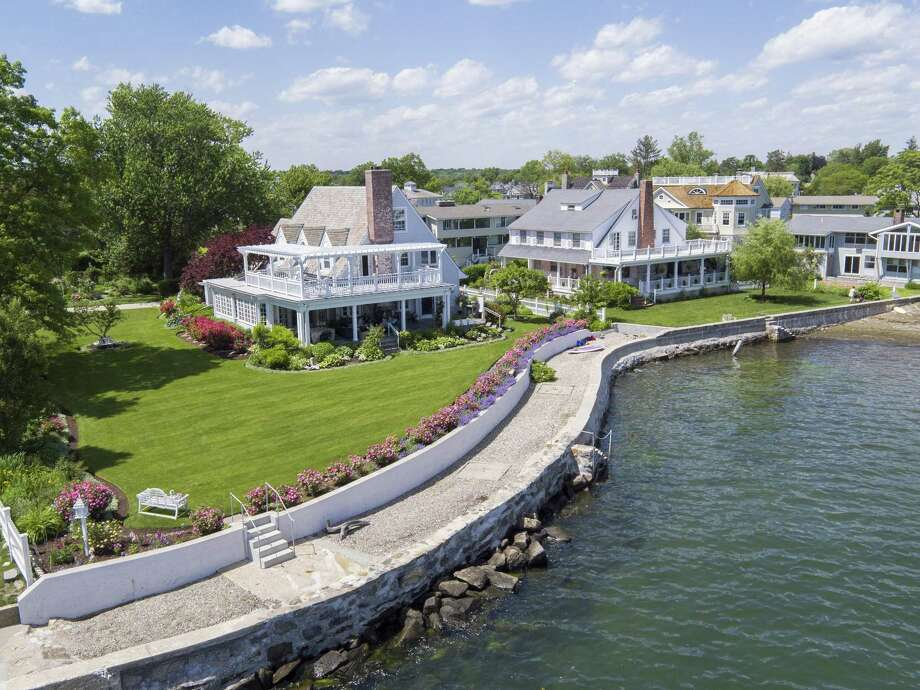 The Lucas Point Association home at 198 Shore Road is situated waterfront, on a 0.64-acre lot near Greenwich Point. The property is listed for $4.999 million by Halstead Property. Photo: Halstead Property / ONLINE_CHECK