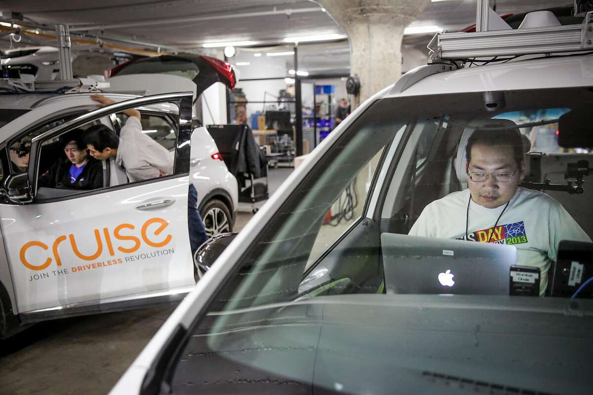 Jason Chinn (right) and brothers Henry Yan (left) and Joe Yan (center) work at Cruise Automation, an autonomous car company in the South of Market district of San Francisco, in March.