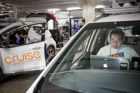Jason Chinn (right) and brothers Henry Yan (left) and Joe Yan (center) work at Cruise Automation, an autonomous driving car company in the SOMA district of San Francisco, California, on Tuesday, March 14, 2017.