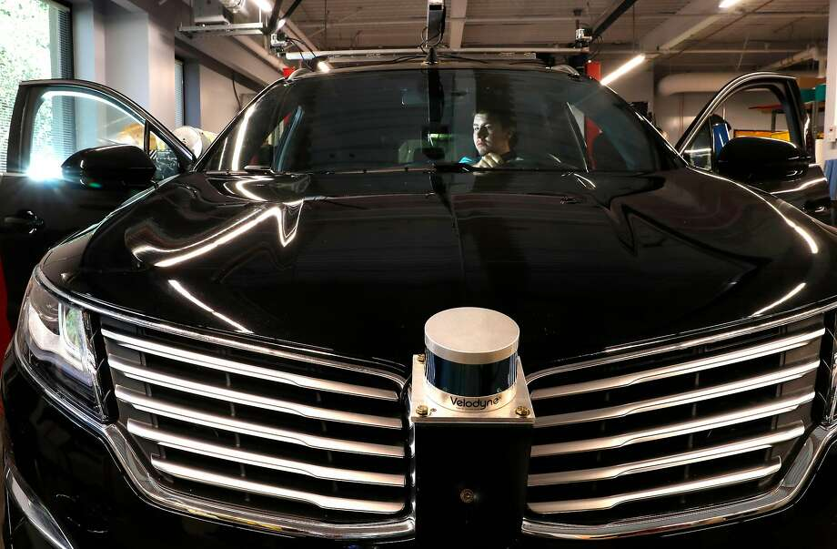 Engineering support intern Austin Peak sits in a test vehicle with the Velodyne lidar sensor mounted on the front of the car at the Ford Research and Innovation Center in Palo Alto in July. Photo: Michael Macor, The Chronicle