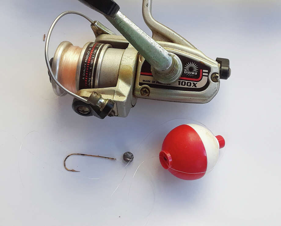 Below the reel are the rest of the rig you need to go fishing: hook, split shot and bobber. Photo: Larry J. LeBlanc