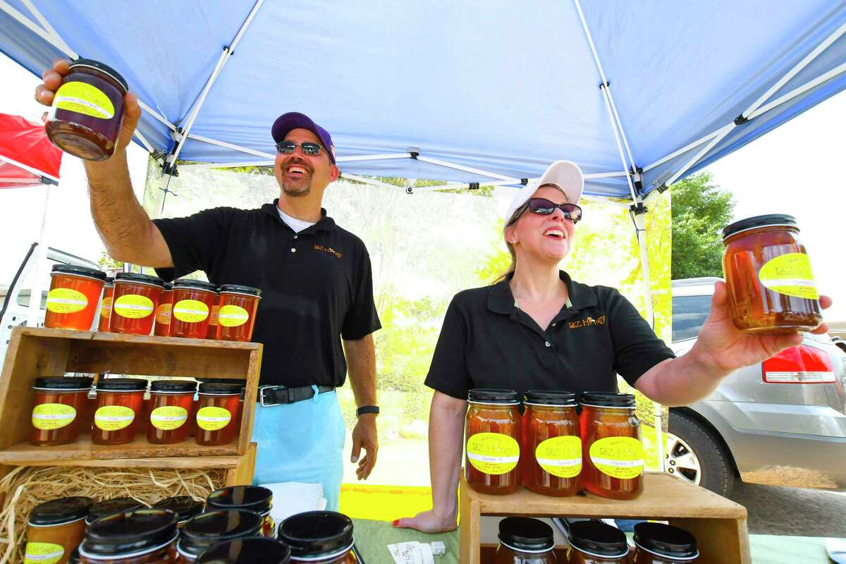 Jersey Village High School math teacher Matt Brantley and wife Kelly Brantley sell their BZ Honey. The honey is from local honey and beekeeping supplies. The honey hives come from Cypress, Katy, and Tomball. The Jersey Village Farmers Market opened July 2. The market, which is held outside of City Hall at 16327 Lakeview Drive, will be held the first Sunday of each month from noon to 3 p.m.