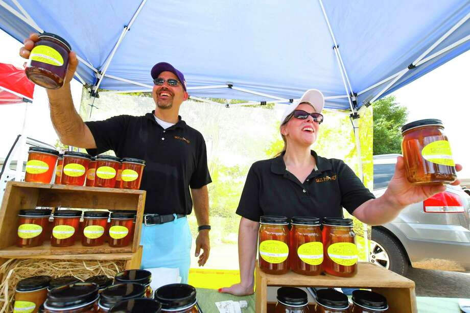 Jersey Village High School math teacher Matt Brantley and wife Kelly Brantley sell their BZ Honey.  The honey is from local honey and beekeeping supplies. The honey hives come from Cypress, Katy, and Tomball. The Jersey Village Farmers Market opened July 2. The market, which is held outside of City Hall at 16327 Lakeview Drive, will be held the first Sunday of each month from noon to 3 p.m. Photo: Tony Gaines, Photographer