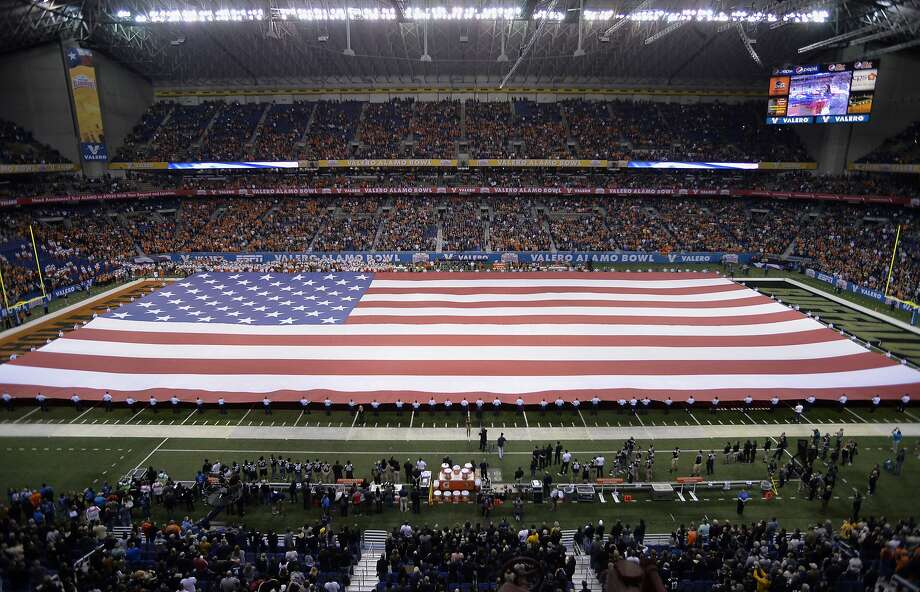 A giant American flag is unfurled during the national anthem before the Alamo Bowl, Thursday, Dec. 29, 2016, at the Alamodome in San Antonio. (Darren Abate/For the Express-News) Photo: Darren Abate, San Antonio Express-News