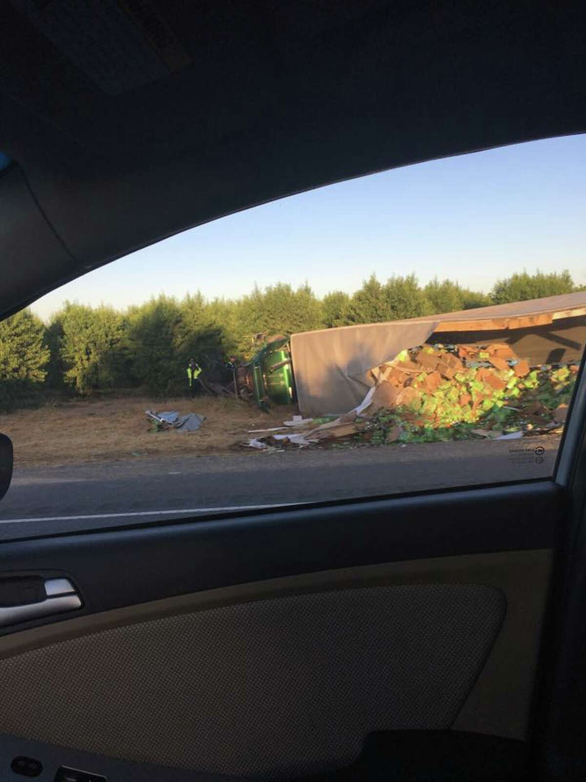 A Sierra Nevada truck carrying a load of bottled beer spilled its contents on Hwy. 99 Wednesday after colliding with a Toyota Camry early that morning.