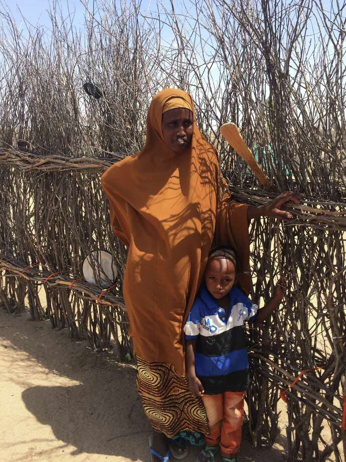 Medina, shown with one of her children, is facing starvation in Kenya because of lingering doubt. There are reasons U.S. compassion should stretch abroad. Photo: /Michael Gerson