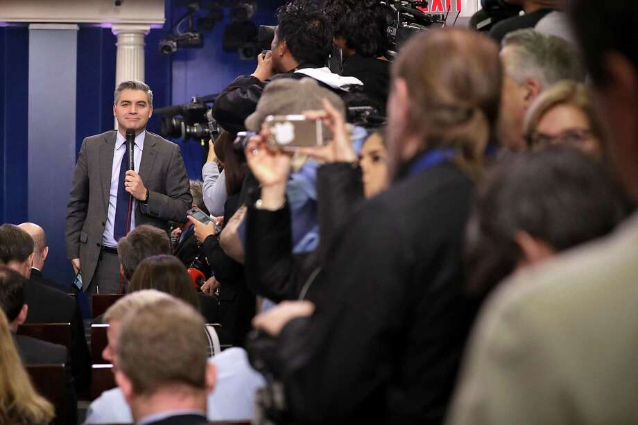 WASHINGTON, DC - JANUARY 23:  CNN's Jim Acosta reports ahead of White House Press Secretary Sean Spicer's daily press briefing in the James Brady Press Briefing Room at the White House January 23, 2017 in Washington, DC. Other than delivering a statement on Saturday critical of reporting about President Donald Trump's inauguration, this will be Spicer's first news conference at the White House.  (Photo by Chip Somodevilla/Getty Images) Photo: Chip Somodevilla, Staff / Getty Images / 2017 Getty Images