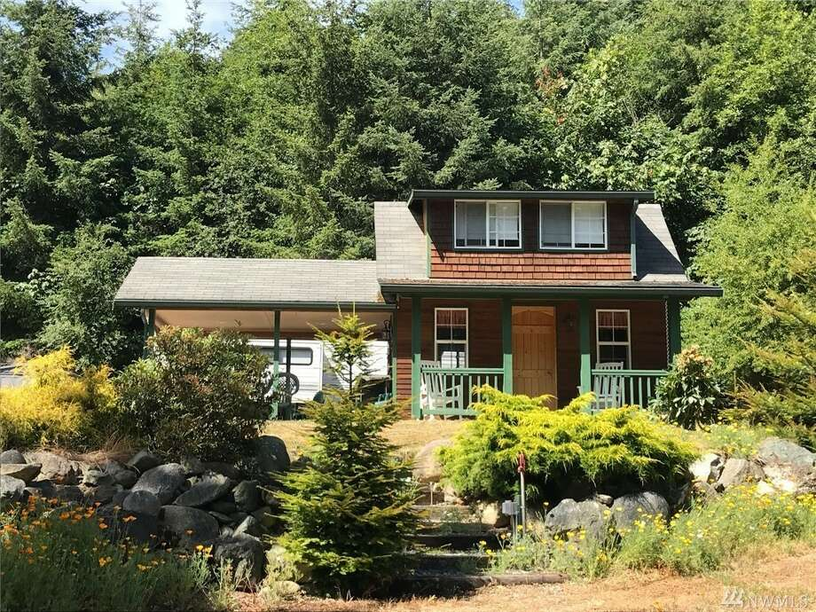 The first home, at 7051 Holiday Blvd., is listed for $125,000.The home is on Guemes Island, which is a small island just north of Anacortes. The home has one bedroom, a three-quarters bathrooms and spans 318 square feet. The property has space for RV and boat parking.You can see the full listing here. Photo: Listing Courtesy Margi Houghton, Windermere RE Anacortes Prop.