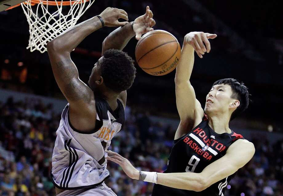 FILE - In this Monday, July 10, 2017, file photo, Houston Rockets' Zhou Qi, right, of China, fouls Phoenix Suns' Marquese Chriss during the second half of an NBA summer league basketball game in Las Vegas. When the Rockets signed Zhou and the Dallas Mavericks brought in Ding Yanyuhang to play on their summer league teams, there was some cynicism the moves were purely financially motivated for teams to tap more directly into the lucrative Chinese market. But little by little both are playing like they belong at the NBA's summer league. (AP Photo/John Locher, File) Photo: John Locher, STF / Copyright 2017 The Associated Press. All rights reserved.