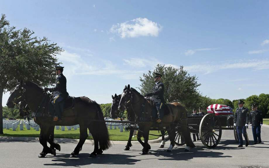 ABOVE: The Fort Sam Houston Caisson Section escorts the casket of U.S. Army Cpl. Frank Luna Sandoval during a burial ceremony at Fort Sam Houston National Cemetery, Tuesday, July 11, 2017. Sandoval was missing action and presumed dead since the Korean War. Sandoval was 20-years-old when he was take as a prisoner of war and died of malnutrition. Sandoval was reported missing in action on Feb. 13, 1951 and declared dead over two and a half years later. He body was returned to U.S. custody in 1954 and he was buried as an unknown soldier in Hawaii for decades. Photo: JERRY LARA / San Antonio Express-News / San Antonio Express-News