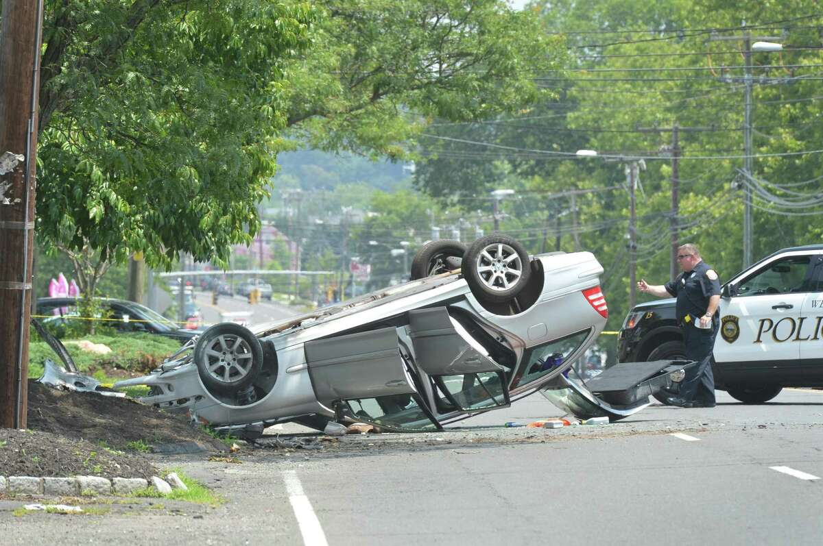 Westport Police investigate a serious motor-vehicle accident involving a Mercedes sedan on Post Rd. East on Wednesday July 12, 2017 in Westport Conn. The Post Rd was closed between Maple Ave. And Bulkley Ave. Wednesday morning so police could investigate the cause.