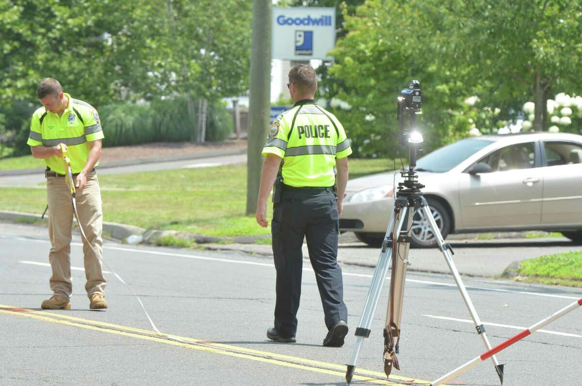 Westport Police take measurements as they investigate a serious motor-vehicle accident involving a Mercedes sedan on Post Rd. East on Wednesday July 12, 2017 in Westport Conn. The Post Rd was closed between Maple Ave. And Bulkley Ave. Wednesday morning so police could investigate the cause.