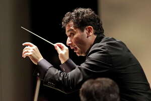 The Houston Symphony with its new music director Andres Orozco-Estrada is shown during performance at Miller Outdoor Theatre, 6000 Hermann Park Dr., Friday, Sept. 12, 2014, in Houston. ( Melissa Phillip / Houston Chronicle )
