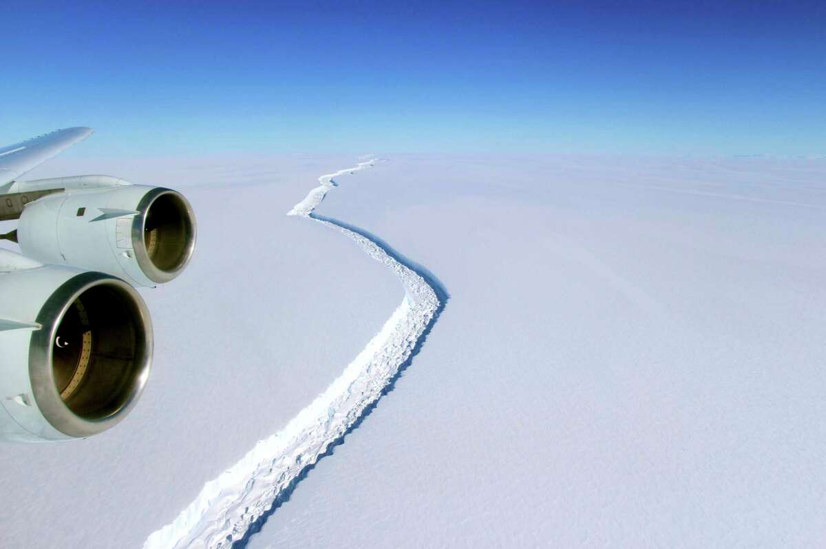 This Nov. 10, 2016 aerial photo released by NASA, shows a rift in the Antarctic Peninsula's Larsen C ice shelf. A vast iceberg with twice the volume of Lake Erie has broken off from a key floating ice shelf in Antarctica, scientists said Wednesday July 12, 2017 The iceberg broke off from the Larsen C ice shelf, scientists at the University of Swansea in Britain said. The iceberg, which is likely to be named A68, is described as weighing 1 trillion tons (1.12 trillion U.S. tons).(John Sonntag/NASA via AP)