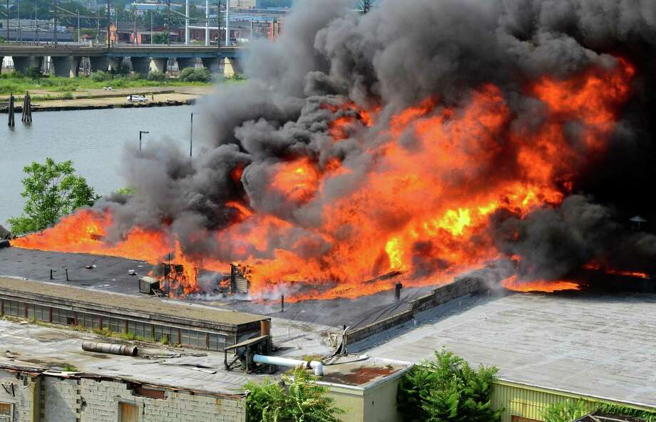 Fire erupts from an abandoned factory complex along Stratford Avenue in Bridgeport, Conn., on Wednesday July 12, 2017. Photo: Christian Abraham / Hearst Connecticut Media / Connecticut Post