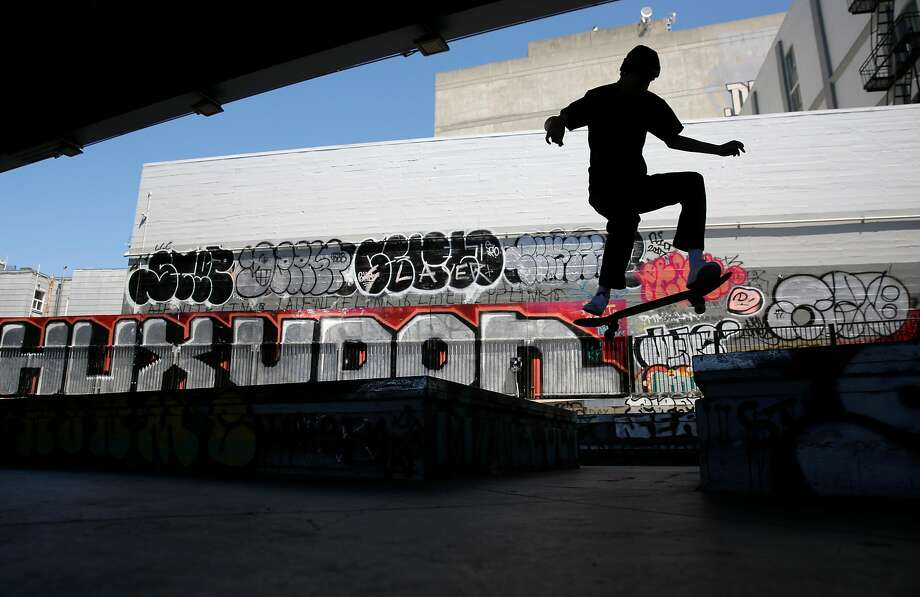 A skateboarder performs a jump at the SoMa West Skatepark, one of a few skateboard havens in the city. Photo: Michael Macor, The Chronicle