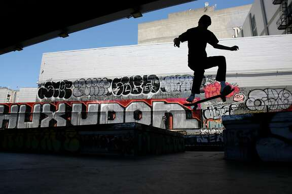 A skateboarder performs a jump at the SoMa West Skatepark in San Francisco, Ca., on Wednesday July 12, 2017.
