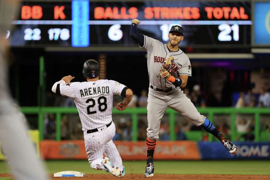 MIAMI, FL - JULY 11:  Carlos Correa #1 of the Houston Astros and the American League turns a double play against Nolan Arenado #28 of the Colorado Rockies and the National League in the second inning during the 88th MLB All-Star Game at Marlins Park on July 11, 2017 in Miami, Florida.  (Photo by Mike Ehrmann/Getty Images) Photo: Mike Ehrmann, Staff / 2017 Getty Images