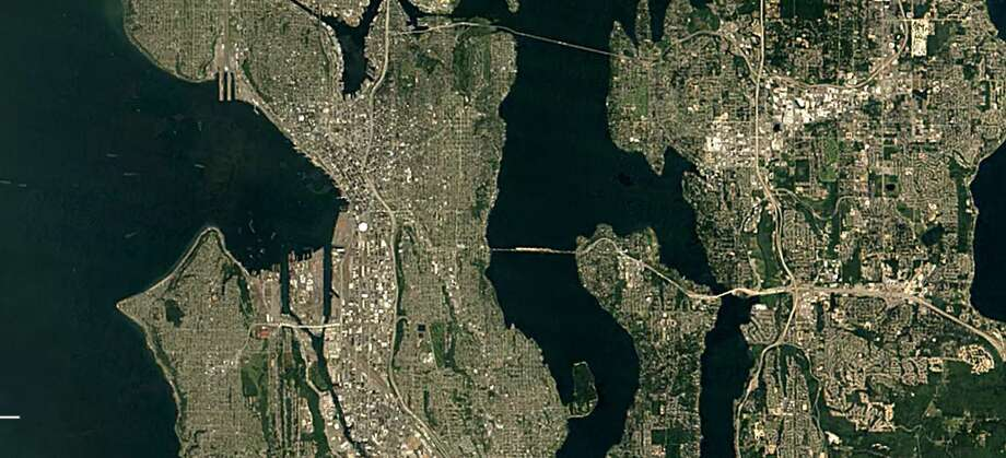 Watch Seattle and Bellevue expand, infill and wreck traffic! Here are the two in 1984. Photo: Google Earth Timelapse