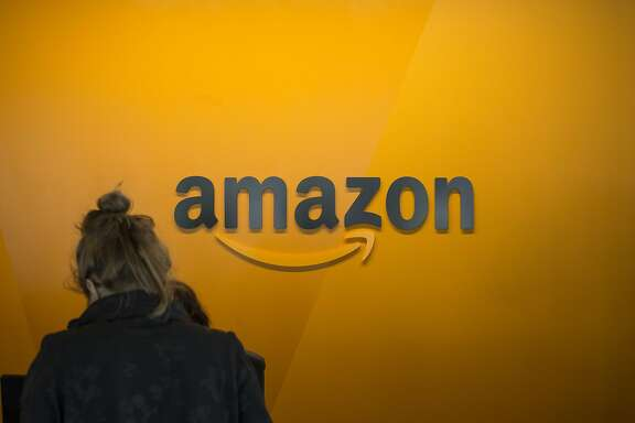 SEATTLE, WA - JUNE 16: A visitor checks in at the Amazon corporate headquarters on June 16, 2017 in Seattle, Washington. Amazon announced that it will buy Whole Foods Market, Inc. for over $13 billion.  (Photo by David Ryder/Getty Images)