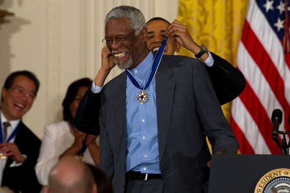 FILE � President Barack Obama presents the Medal of Freedom to Bill Russell, the former Boston Celtics player-coach, in the East Room of the White House in Washington, Feb. 15, 2011. Russell, who revolutionized the game with his defensive prowess from the center position, will receive the 2017 Lifetime Achievement Award at the inaugural NBA Awards show. (Doug Mills/The New York Times)