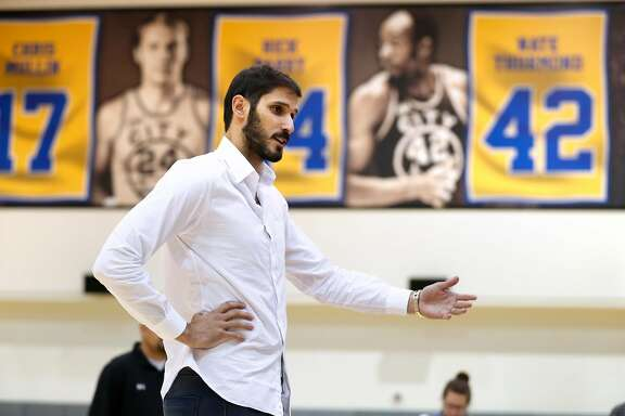 Golden State Warriors' Omri Casspi talks to basketball campers after Casspi was introduced in Oakland, Calif. on Wednesday, July 12, 2017.
