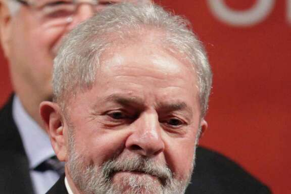 Brazil's Former President Luiz Inacio Lula da Silva arrives to attend the inauguration ceremony  of the new Workers' Party directory and of the new party president Gleisi Hoffmann, in Brasilia, Brazil, Wednesday, July 5, 2017. (AP Photo/Eraldo Peres)