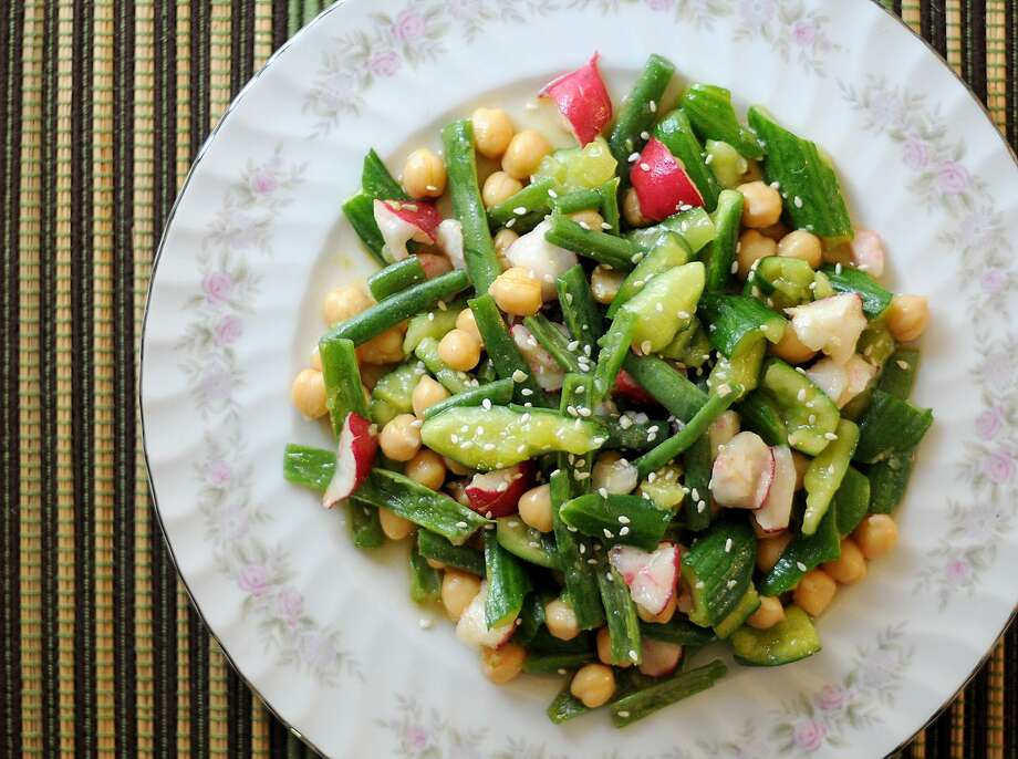 Smashed cucumbers, radishes and green beans soak up a rice vinegar and miso dressing in this nutritious no-cook salad. Photo: Paul Stephen / San Antonio Express-News