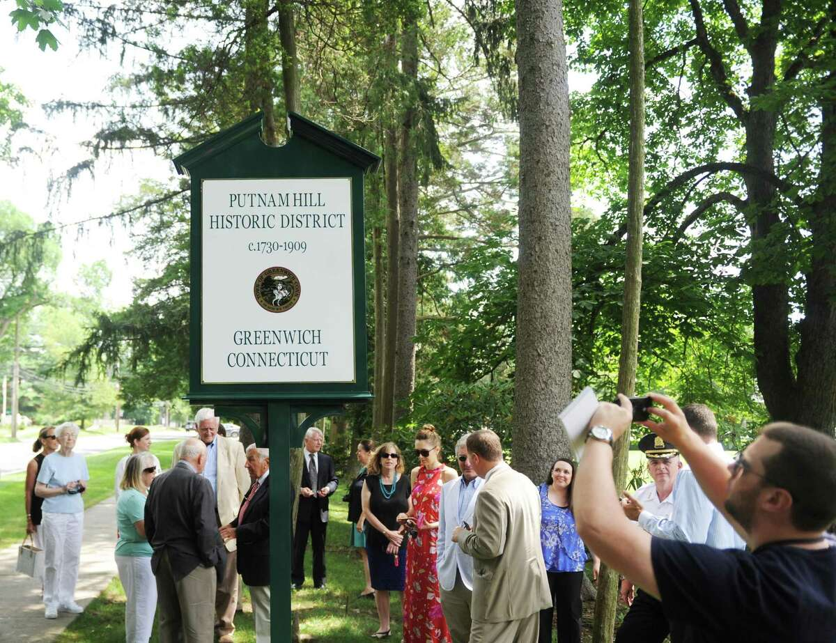 Folks gather for the Greenwich Preservation Network's dedication of Putnam Hill historic marker outside the Tomes-Higgins House in Greenwich, Conn. Wednesday, July 12, 2017. The marker formalizes the historic value of Putnam Hill, which is named after Revolutionary War general Israel Putnam.