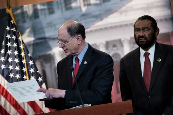 Rep. Brad Sherman (left), D-Calif., and Rep. Al Green, D-Houston, take questions about articles of impeachment against President Donald Trump during a June 7 news conference in Washington, DC. Sherman on Wednesday became the first U.S. lawmaker to formally file an article of impeachment against Trump, which Green signed.