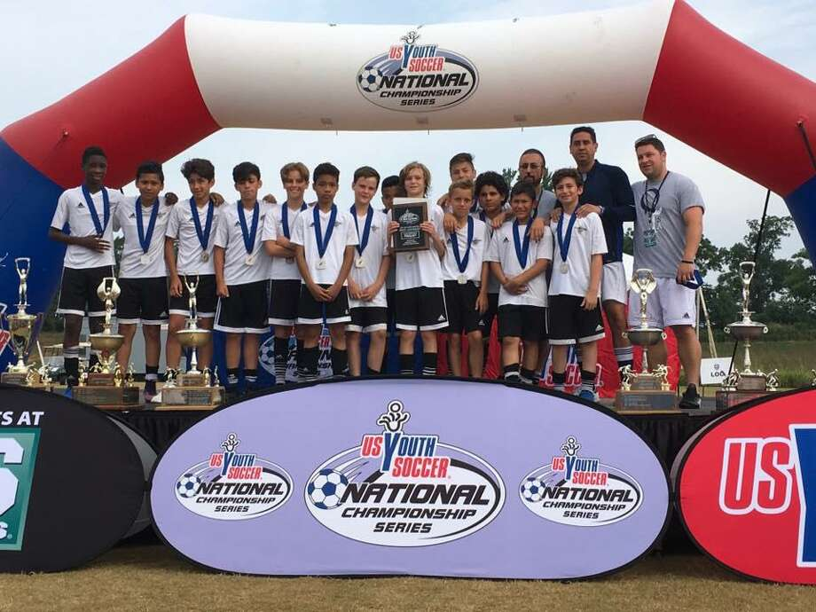 The Stamford Youth Soccer League's Stamford FC U12 Boys Elite, who won the CT State Cup in June, defeated four top teams from top clubs to finish 2nd in the east coast region at the distinguished 2017 US Youth Soccer National Championship Series, one of the oldest and most prestigious national youth soccer tournaments. From left to right:  Darsein Gabriel, Edwin Medina, Massimo Costa, Lucas Fernandez, Antonio Ninivaggi, Oscar Gonzalez, Johnny Couch, Sebastian Caltenco (behind), Luke Vander Kolk (holding award), Will Anderson, Arian Recinos (behind Will Anderson), Lyon Atiencia, Sebastian Ortiz Salazar, Will Herckis, and QTSA Coaches, Mike  Tripuzzi, Head Coach Jason Segovia, and Enzennio Mallozzi. Photo: Contributed Photo / Contributed Photo / Stamford Advocate Contributed