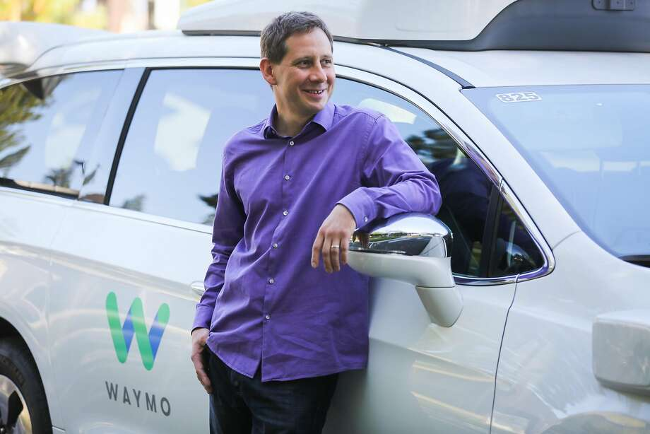 Dmitri Dolgov, the head of self-driving technology at Waymo, with a Waymo car in Mountain View in July. Photo: Gabrielle Lurie, The Chronicle